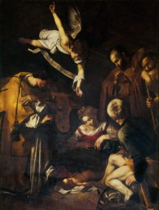 Saints gathered round; an angel overhead; the baby in his mother's lap.