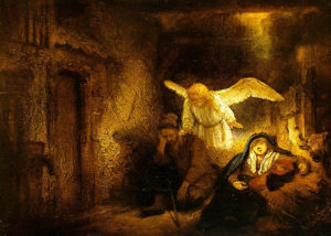 A dark, brown-tones manger is lit by an angel hovering over the slump-sleeping Joseph's shoulders; Mary in blue is off to the other side, leaning against the straw manger.