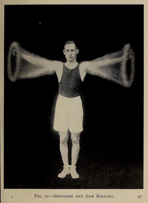 An athletic 1917 business man with black tank top, white knee-length shorts, white tennis shoes, and dark hair neatly parted and just beginning to receded. A composite pose of him exercising. In this case circling his arms while looking debonairly ahead. Face very serious and straight-ahead. This businessman means business!